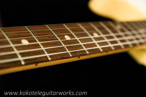 Fresh grind & polish on original frets.  The frets are very low, but play nicely.